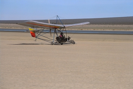 Ultra-light Aircraft at El Mirage Dry Lake Bed.An ultra-light aircraft  takes off on the dry lake bed.