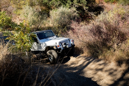 Jeep AdventuresA jeep navigates a dirt trail at the Cow Mountain Recreation Area.