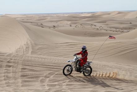 MotorcyclistA motorcyclist enjoys the sand dunes.