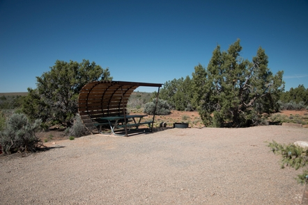 CampsiteCampsites have picnic tables with shade structures